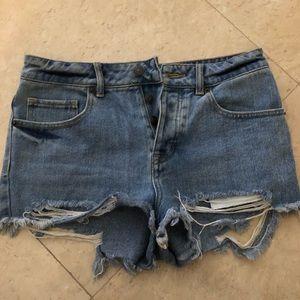 Brandy Melville Mid-Rise Distressed Denim Shorts
